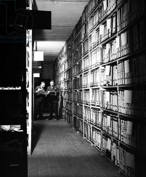 NUREMBERG TRIALS, 1947 Nazi Party files at the Berlin Document Center in Berlin, Germany, being screened for possible use in the war crimes trials at Nuremberg, 1947.