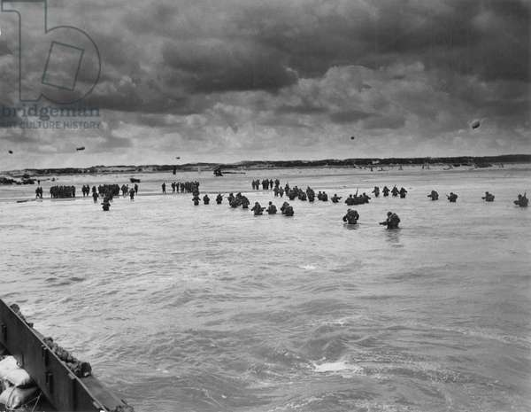 WORLD WAR II: D-DAY, 1944 American troops wading ashore at Utah Beach during the invasion of Normandy, 6 June 1944.