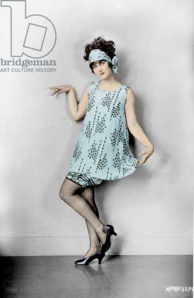 FASHION: FLAPPER, 1925 American flapper. Photograph, 1925, digitally coloured  by Granger, NYC