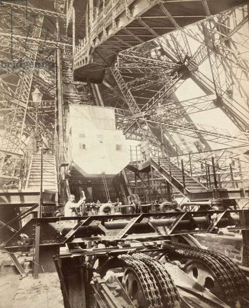 EIFFEL TOWER, c.1888 A man operating the interior machinery of the Eiffel Tower in Paris, France. Photograph, c.1888.