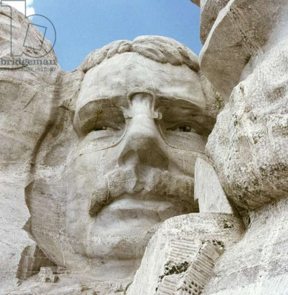 MOUNT RUSHMORE, c.1970 Close up of President Theodore Roosevelt on the Mount Rushmore National Memorial in South Dakota. Photograph, c.1970.