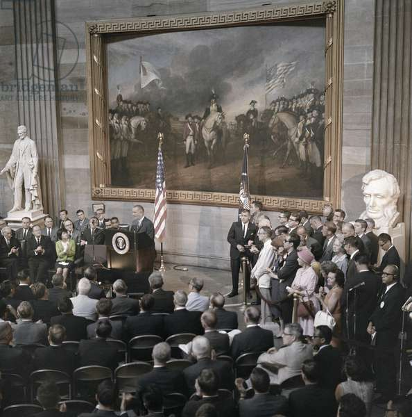 LYNDON BAINES JOHNSON (1908-1973). 36th President of the United States. Delivering remarks at the signing ceremony for the Voting Rights Act. Photograph by Frank Wolfe, 6 August 1965.
