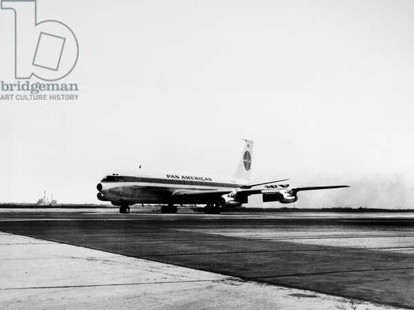 BOEING 707 PLANE, 1958 A Boeing 707 jet clipper operated by Pan American Airlines landing at New York International Airport in August 1958.