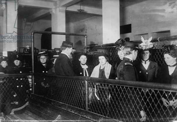ELLIS ISLAND, c.1900 Immigrants arriving at Ellis Island, c.1900.