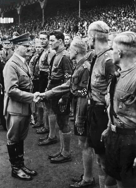 HITLER YOUTH, 1937 Adolf Hitler shaking hands with Hitler Youth at a stadium in Nuremberg, Germany. Photograph, 1937.