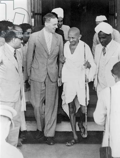 MOHANDAS GANDHI (1869-1948) Hindu nationalist and spiritual leader. Photographed with Sir Stafford Cripps in New Delhi, India, 1942.