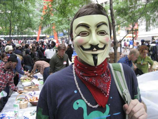 OCCUPY WALL STREET, 2011 A protester at the Occupy Wall Street encampment in Zuccotti Park, New York City, wearing a Guy Fawkes mask, made popular by the graphic novel 'V for Vendetta,' and which has become associated with various anti-establishment activists. Photograph, October 2011.