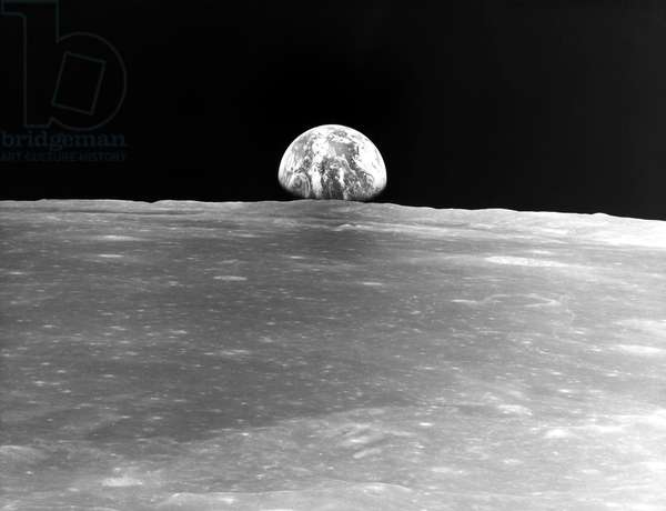 APOLLO 11: EARTHRISE, 1969 Photograph taken from the Apollo 11 spacecraft, showing the Earth rising about the Moon's horizon, July 1969.