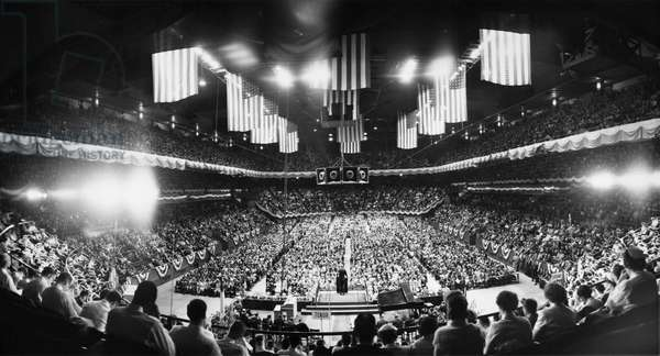 BILLY GRAHAM (1918- ) William Franklin Graham. American evangelist. Graham giving a speech before a large crowd in Madison Square Garden in New York City, 16 May 1957.