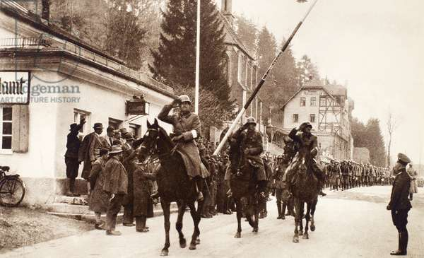 AUSTRIA: ANSCHLUSS, 1938 The frontier barrier is raised at Kufstein as German troops march into Austria. Photograph 12 March 1938.