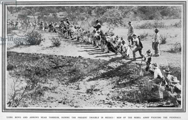 MEXICAN REVOLUTION, 1914 Some of Pancho Villa's men, with bows and arrows, fighting Federal troops near Torreo, Mexico, Spring 1914. Photograph from an English newspaper.