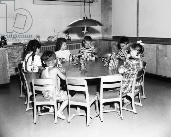 ELLIS ISLAND, 1951 A group of young immigrants from Europe enjoying themselves in the playroom at Ellis Island, the immigration station in New York Harbor, 1 August 1951. Their parents, meanwhile, are being questioned by the immigration authorities.