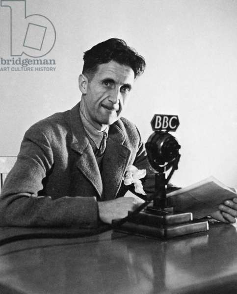 GEORGE ORWELL (1903-1950) Pseudonym of Eric Blair. English novelist and essayist. Orwell broadcasting over the BBC in London in 1943.