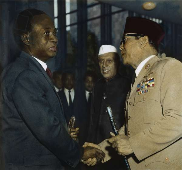 NKRUMAH AND SUKARNO, 1960 President Kwame Nkrumah of Ghana (left) shaking hands with President Sukarno of Indonesia at the United Nations in New York, 4 October 1960, while Prime Minister Jawaharlal Nehru of India watches. Oil over a photograph.