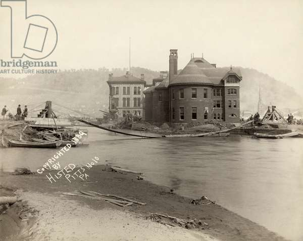 JOHNSTOWN FLOOD, 1889 A pontoon bridge across Conemaugh River in Johnstown, Pennsylvania, after the Johnstown Flood. Photograph by Ernest Walter Histed, 1889.