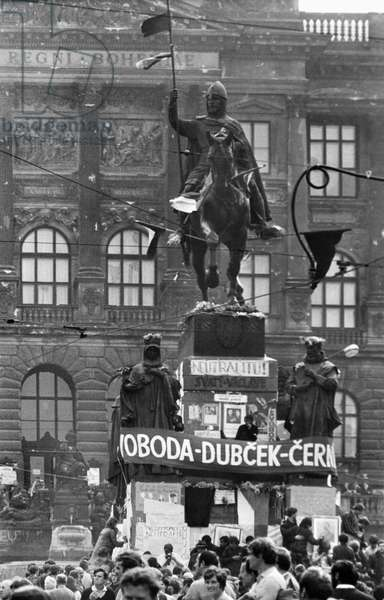 CZECH PROTEST, 1968 Crowds of protesters gathered around a statue in Wenceslas Square in Prague, around which is a banner supporting Czech leaders Ludvik Svoboda, Alexander Dubcek, and Oldrich Cernik, 23 August 1968, three days after the Soviet-led Warsaw Pact invasion of Czechoslovakia.