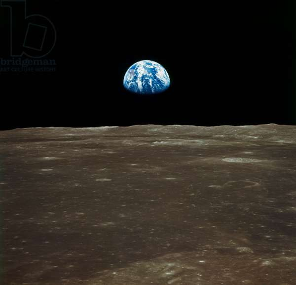 APOLLO 11: EARTH, 1969 A view of earth rising over the Moon's horizon. Photographed from the Apollo 11 spacecraft, 1969.