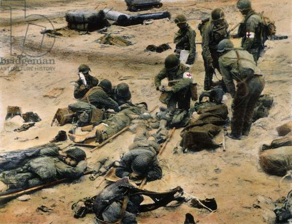 WORLD WAR II: D-DAY, 1944 American medics administer first aid to soldiers wounded in the initial attack at Omaha Beach during the invasion of Normandy, France, 9 June 1944. Oil over a photograph.