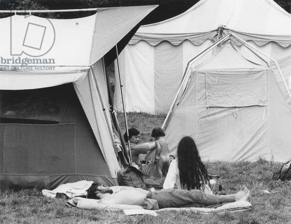 WOODSTOCK, 1969 Hippies at Woodstock camp out behind the scenes.