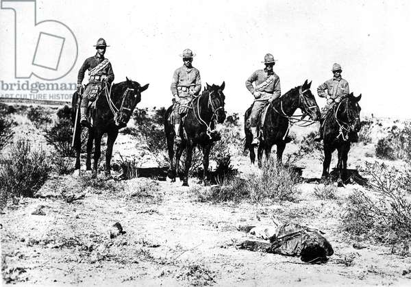 PANCHO VILLA RAID, 1916 Columbus, New Mexico, 13th Cavalry United States soldiers and a dead Mexican, 1916.