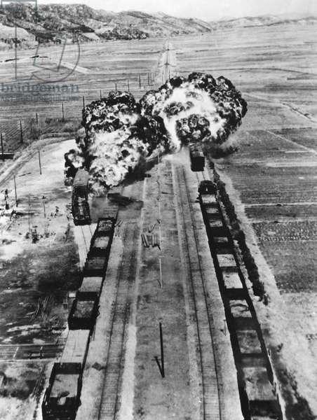 KOREAN WAR: NAPALM RAID Napalm raid by U.S. Air Force B-26 Invaders on a railroad junction at Munchon, North Korea. Photographed c.1950.