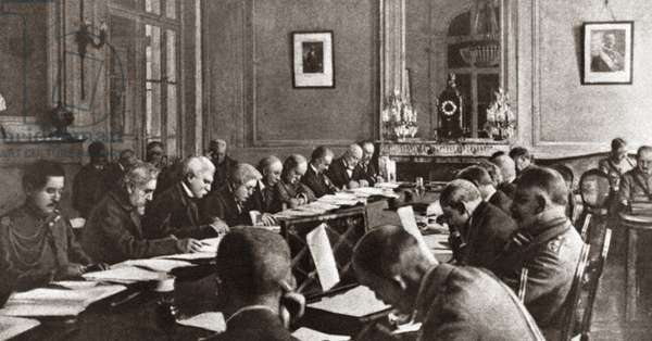 WORLD WAR I: ARMISTICE Writing of the Armistice Terms by the Interallied Conference. From left is di Robilant, Sonnino, Orlando, E.M. House, Bliss, Venizelos and Vesnitch. From right is Wemyss, Wilson, Haig, Sackville West, Law, George, Clemenceau and Pichon at Versailles, France. Photograph, c.1916.