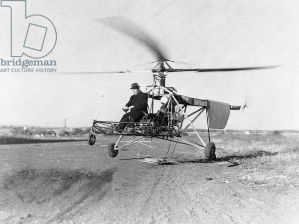 IGOR IVAN SIKORSKY (1889-1972). American (Ukrainian-born) aeronautical engineer. Sikorsky with his VS-300 helicopter during its first test flight. Photograph, 14 September 1939.