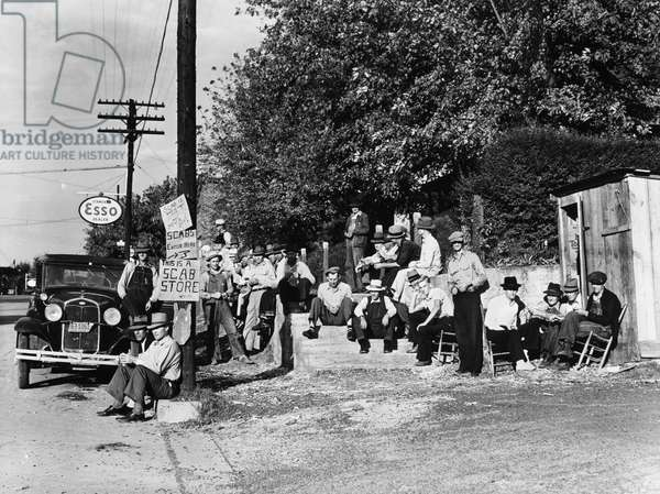 MINER STRIKE, 1939 Striking copper miners picket a company store in Ducktown, Tennessee. Photograph by Marion Post Wolcott, September 1939.