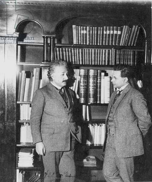 ALBERT EINSTEIN (1879-1955) American (German-born) theoretical physicist. In his study with his son, Dr. Hans Albert Einstein. Photographed by Lotte Jacobi, 1927.