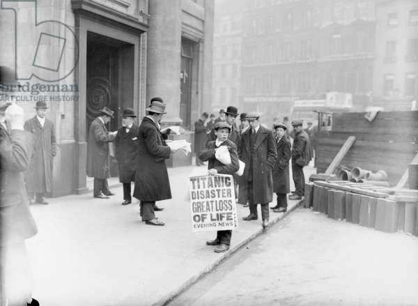 TITANIC DISASTER, 1912 A newsboy selling newspapers announcing the sinking of the White Star liner 'Titanic,' following its collision with an iceberg in the North Atlantic. Photograph, April 1912.