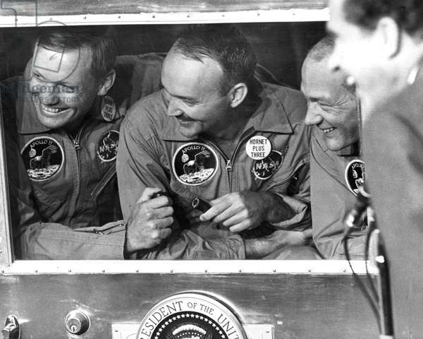 SPACE: APOLLO 11, 1969 Astronauts Neil Armstrong, Michael Collins, and Edwin 'Buzz' Aldrin in the quarantine, laughing with President Richard Nixon, following the Apollo 11 mission. Photograph, 1969.