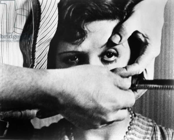 UN CHIEN ANDALOU, 1929 Simone Mareuil's eye ready to be cut in a scene from Luis Buñuel and Salvador Dali's surrealist short film 'An Andalusian Dog,' France, 1929.