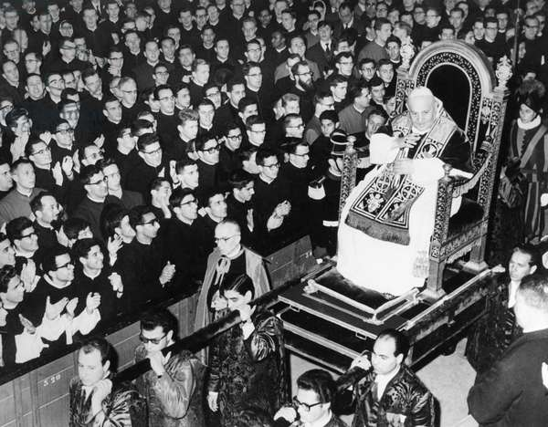 JOHN XXIII (1881-1963) Pope, 1958-1963. Blessing the crowd while being carried on his throne in St. Peter's Basilica in Rome, 22 February 1962.