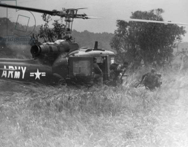VIETNAM WAR: HELICOPTER U.S.Army soldiers debark from a UH-1B helicopter in central South Vietnam, n.d.