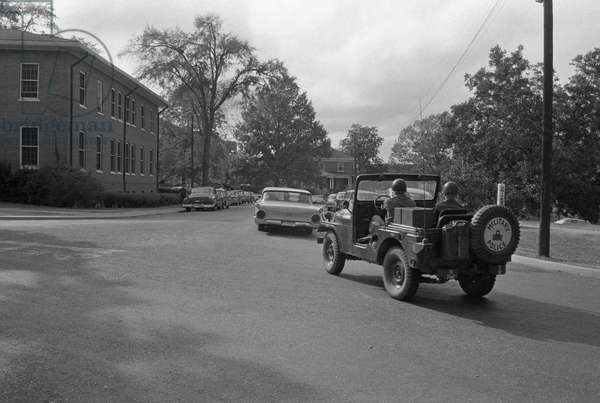 INTEGRATION: OLE MISS, 1962 A military jeep escorting the car carrying James Meredith, the first black student at the University of Mississippi campus in Oxford, Mississippi. Photograph, Marion S. Trikosko, 9 October 1962.