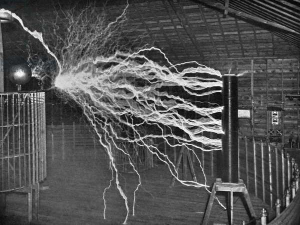 TESLA'S LABORATORY, c.1900 An experiment to illustrate the capacity of the oscillator for producing electrical explosions of great power, in Nikola Tesla's laboratory in Colorado Springs, Colorado. Photograph by Dickenson V. Alley, c.1900.