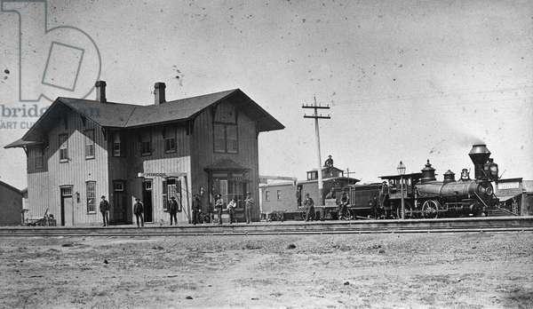 SANTA FE RAILWAY, 1883 The Santa Fe Railway depot in Rincon, New Mexico. Photograph, 1883.