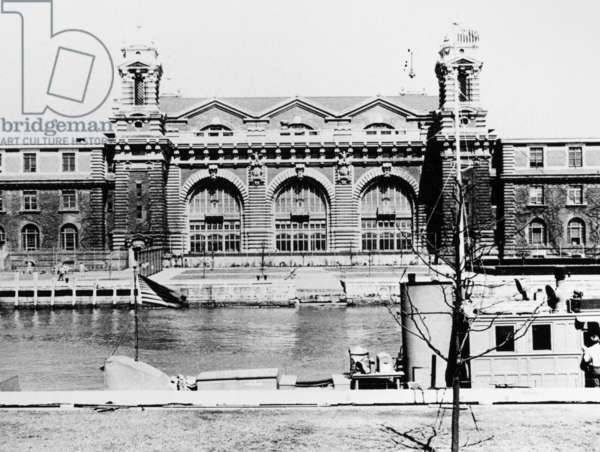 ELLIS ISLAND, c.1943 The main building of Ellis Island, when it served as a detention center for 'alien enemies' during World War II. Photograph, c.1943.