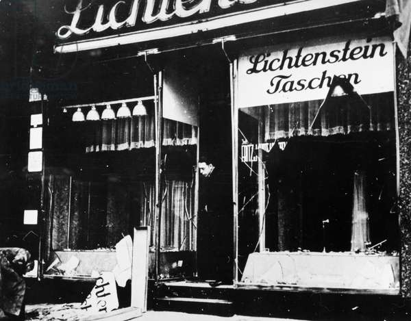 KRISTALLNACHT, 1938 A Jewish proprietor in Berlin, Germany, inspecting his shop after it had been looted and destroyed in the Kristallnact pogrom, 10 November 1938.
