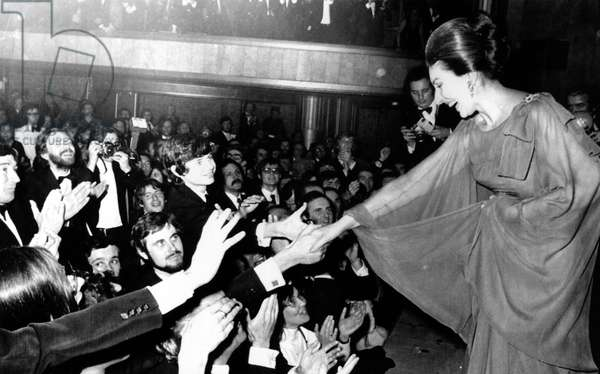MARIA CALLAS (1923-1977) American operatic soprano. Callas greeting fans after a recital at the Champs-Élysées Theater in Paris, 7 December 1973.