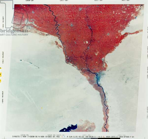 EARTH FROM SPACE, 1972 A view from space of the Nile River flowing through Cairo, Egypt (right center), and the surrounding region, with areas of vegetation shown in bright red. Part of Lake Qarun appears at bottom center. Composite of photographs taken by NASA's Earth Resources Technology Satellite-1 (ERTS-1, later renamed Landsat 1), 31 August 1972.