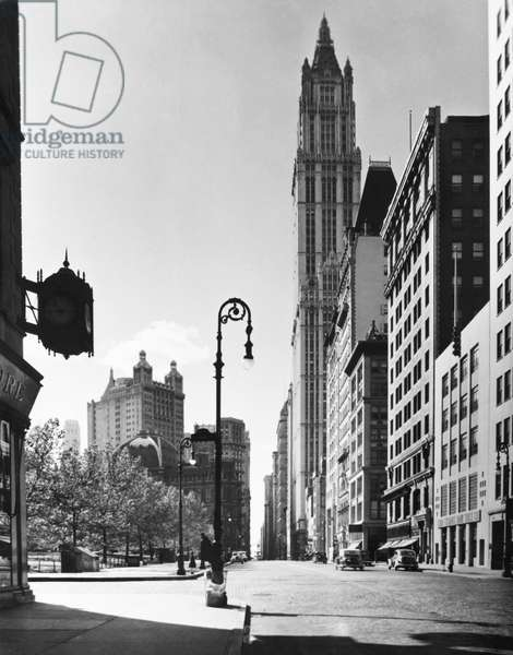 WOOLWORTH BUILDING, c.1940 The Woolworth Building on lower Broadway in New York City, on a quiet day, c.1940.