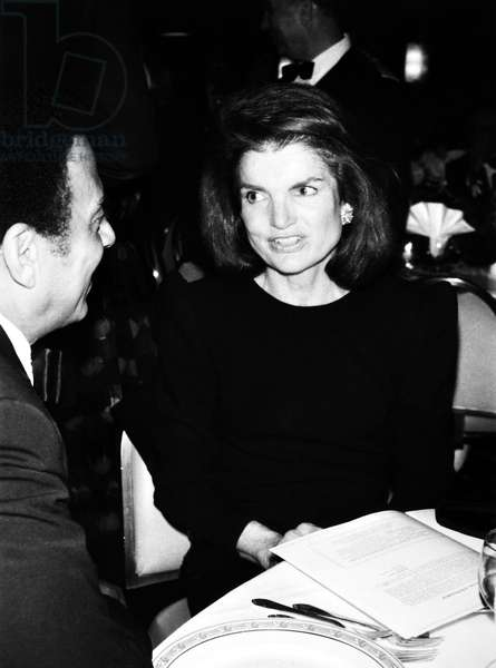 JACQUELINE KENNEDY ONASSIS (1929-1994). Wife of Aristotle Onassis and President John Fitzgerald Kennedy. Onassis with Atlanta Mayor Andrew Young at the African American Institute's thirtieth annual dinner in New York. Photographed 1984.