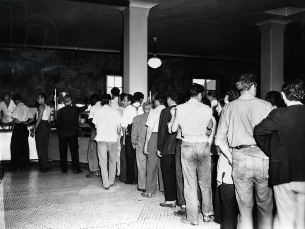 ELLIS ISLAND, 1947 Men waiting in line for a meal in the dining room at Ellis Island. Photograph, 1947.