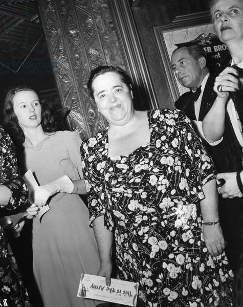 ELSA MAXWELL (1883-1963) American columnist, songwriter and professional party-giver. At the world premiere of Warner Brothers' production of Irving Berlin's 'This is the Army' at the Hollywood Theatre, in New York, 28 July 1943.