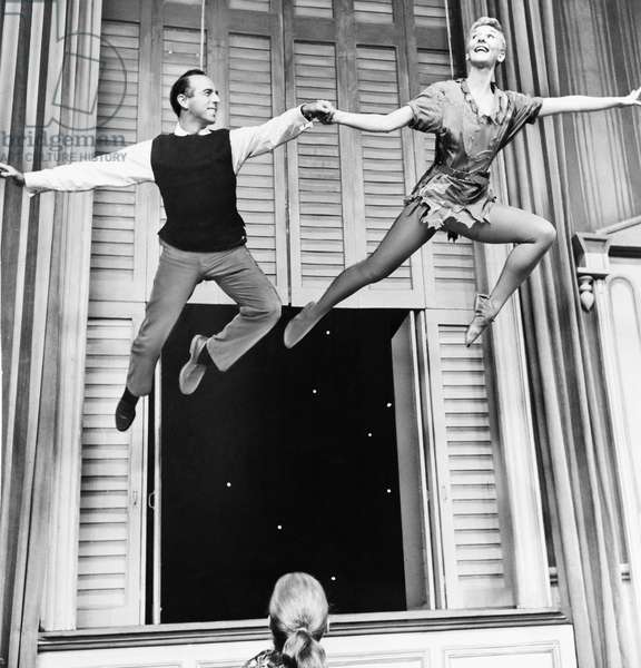 MARY MARTIN (1913-1990) American singer and actress. Photographed with choreographer Jerome Robbins on the set of 'Peter Pan,' 1956.