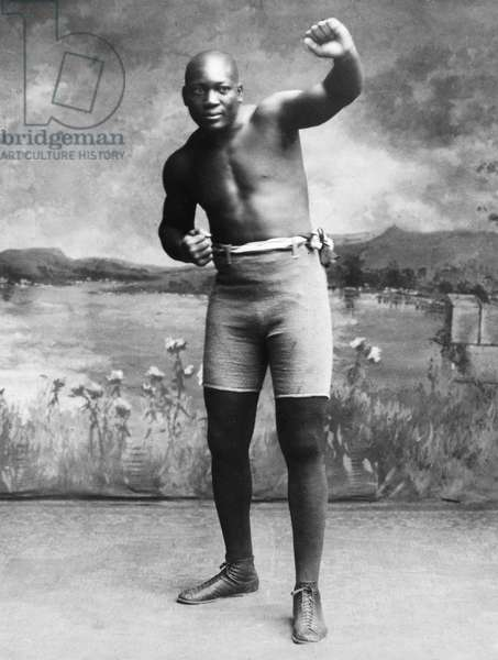 JACK JOHNSON (1878-1946) American heavyweight pugilist. Photographed in 1910.