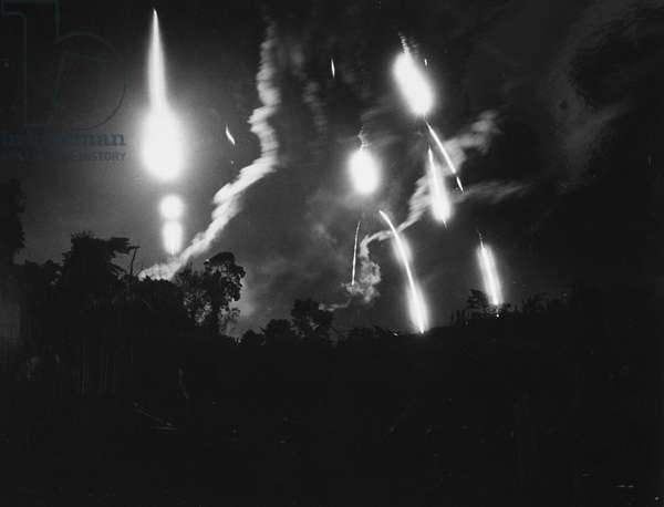 VIETNAM WAR: FLARES, 1966 Flares from an American aircraft and from ground artillery help a U.S. Marine company under attack in South Vietnam near the Demilitarized Zone, September 1966.