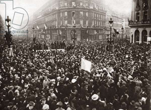WORLD WAR I: CELEBRATION Crowd at The Place De L'Opera celebrating the signing of the armistice. Avenue De L'opera can be seen on the left and Rue De La Paix on the right in Paris, France. Photograph, 1918.
