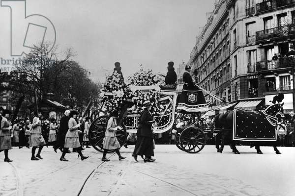SARAH BERNHARDT (1844-1923) French actress. A group of orphans carrying palms alongside Sarah Bernhardt's funeral carriage. Photograph, 1923.